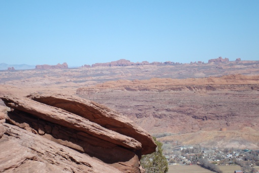 Way off in the distance you can see some of Arches National Park.