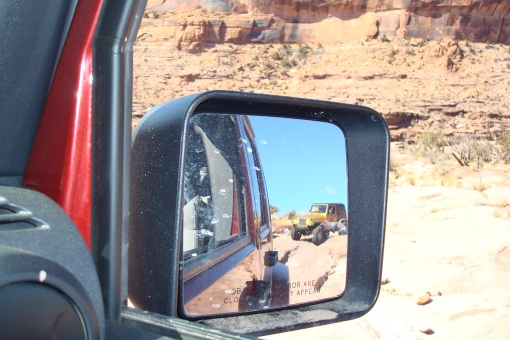 On the way down I couldn't resist getting a pic of A's jeep in the side mirror.