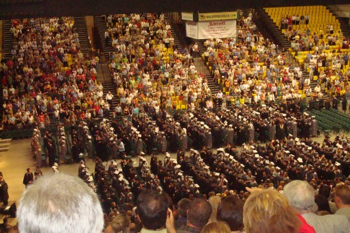 763  graduates waiting to throw their caps into the air.