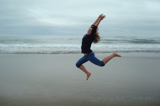 Hoob showing a dance move on the beach in Oregon.